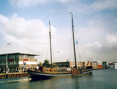 Two mast clipper sailing houseboat