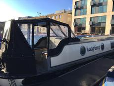 70ft narrowboat on residential mooring on Ice Wharf Marina Kings Cross