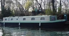 60' x 12' Live aboard with diesel electric hybrid engine.