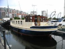 Big Barge on residential mooring