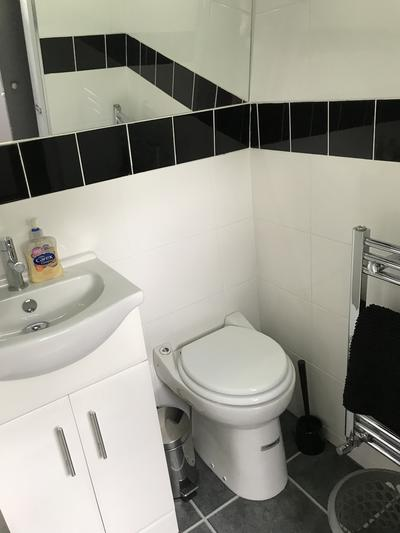 pump-out toilet, sink, and shower rail