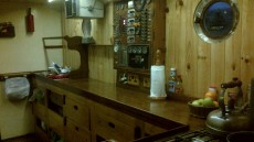 Galley recently insulated and woodpanelled