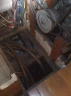 looking into engine room from hold beneath steps