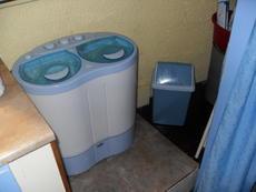 washing machine in shower room