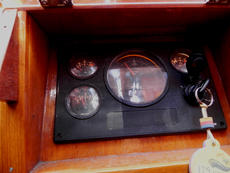 The engine instrument control panel is situated in the cockpit within easy reach of the Helmsman.