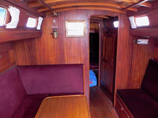 The saloon is warm and cosy with rich mahogany panelling. The head room is over 6ft. The Lewmar skylight hatch in the center of the cabin gives additioal light and ventilation. The cabin is heated by a Eberspacher Airtronic-D2 diesal heater situated in a
