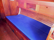 The starboard settee backrest is lowered to make another berth which is around 3ft wide. Both berths have sturdy lee cloths.
