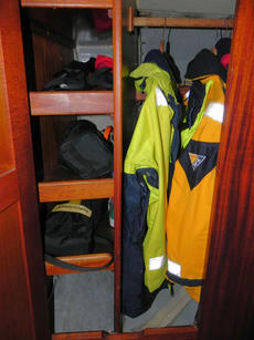 Opposite the toilet compartment is the wardrobe with hanging space for Oilies etc and shelves for other items. A heater outlet is situated in the bottom of the hanging space to help in drying any wet gear. The doors on both the toilet compartment and ward