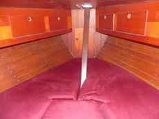 The usual infill provides a double berth around 6ft 6ins in length and up to 6ft 8ins in width. There is 5ft 9ins headroom under the hatch. There are lockers on both sides above the berths and large lockers under the berths.