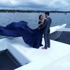 Wedding photoshoot: Couple are standing on aka which joins ama to center hull (wa'a)