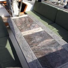 Center Cockpit with Beautiful teak and marble table