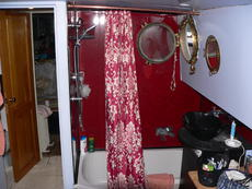 En suite bathroom, sunken bath and shower over. Separate toilet.(view from bed)