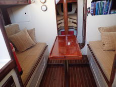 The main cabin with two trotter box berths and dining table