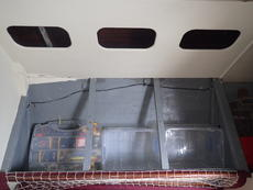Storage behind and under main cabin berths