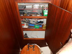 Toilet and spares locker