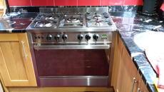 Fan assist rotisserie oven range