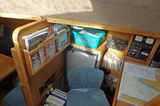 Inside wheelhouse: chart table and fridge