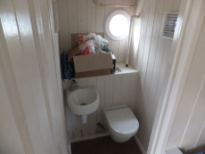 Aft toilet adjoining office space