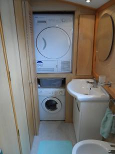 door open showing washer and dryer