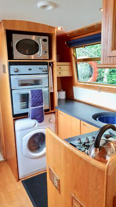 Galley full size washing machine, eye level oven/grill microwave