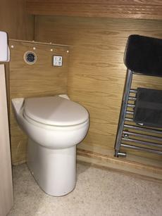 Pump out toilet.