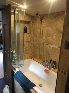 Full sized fitted bath with shower above