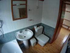 Main bathroom with bath, shower, Echo flush toilet, hand basin.