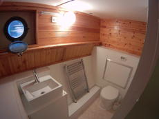 Lower deck shower room with electric tiolet, hand basin.