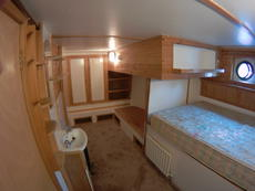 Double bedroom 2 lower deck, with single bunk, hand basin.
