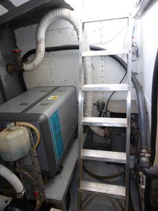 Engine room central heating boiler behind ladder