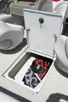 Crownline Bowrider 210 LS - Lockable in-floor wakeboard storage compartment with stainless steel shocks.