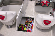 Crownline Bowrider 230 LS - An in-floor wakeboard/ski storage compartment is located beneath the windshield walk-thru area