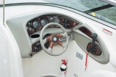 Crownline Bowrider 270 BR - The optional wood-grain dash shown here comes with lifetime warranted gauges and instrumentation