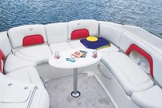 Crownline Bowrider 270 BR - The standard U-wrap cockpit area comes standard with walk-thru filler cushions and cockpit table
