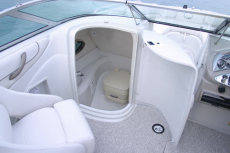 Crownline Deck Boat 220 EX - A convenient head enclosure holds a portable toilet complete with a light, sink and shower