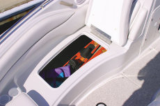 Crownline Deck Boat 260 EX - Bow area features a large side storage compartment that easily holds full length skis