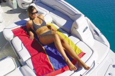 Crownline Deck Boat 240 EX - The aft bench seat back folds down to form a comfortable sunpad without the use of filler cushions