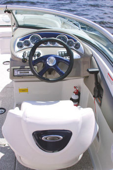 Crownline Deck Boat 240 EX - The helm features optional color-matched dash, tilt racing wheel and full instrumentation